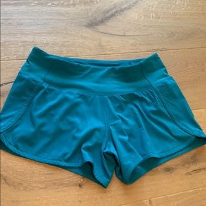 Lululemon teal speed up shorts.